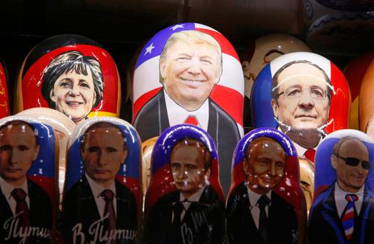 Painted Matryoshka dolls, or Russian nesting dolls, bearing the faces of U.S. President-elect Donald Trump, German Chancellor Angela Merkel, French President Francois Hollande and Russian President Vladimir Putin are displayed for sale at a souvenir shop in central Moscow. REUTERS/Sergei Karpukhin/File Photo