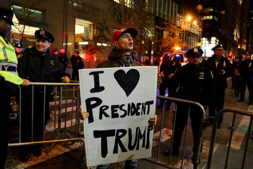 A Donald Trump supporter shouts at opposing demonstrators in New York. Photo: REUTERS/Bria Webb