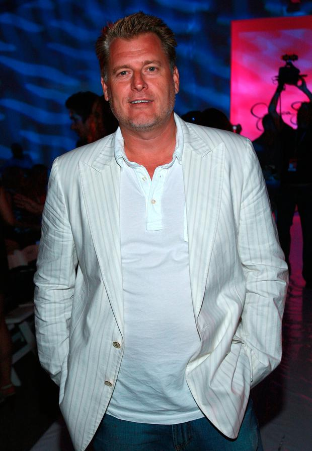 Joe Simpson at the Jessica Simpson swimwear fashion show during