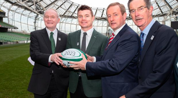 An Taoiseach Enda Kenny leads the way watched by Northern Ireland's First Minister Martin McGuinness, Brian O'Driscoll and Dick Spring at the launch of Ireland's bid for 2023 Rugby World Cup in the Aviva Stadium. Photo: Tony Gavin 15/11/2016