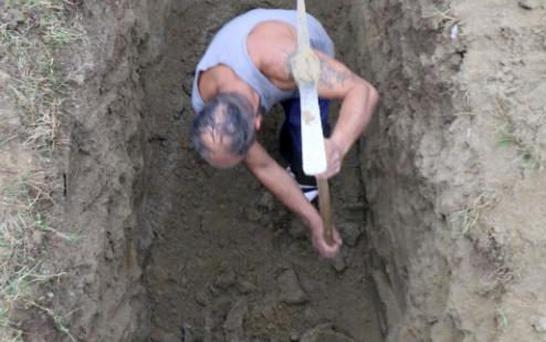 A grave digger - slightly younger than 89 - competes in the Grave Digging Championships in Trencin, Slovakia, last week. CREDIT: AP PHOTO/RONALD ZAK