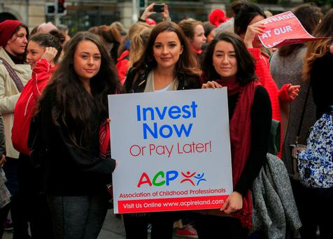 Childcare workers (left to right) Abbie Chandley, from Tougher, Shauna Daly, from Kinsale, and Hannah Crowley, from Skibereen, protesting outside Leinster House. Photo: Gareth Chaney / Collins