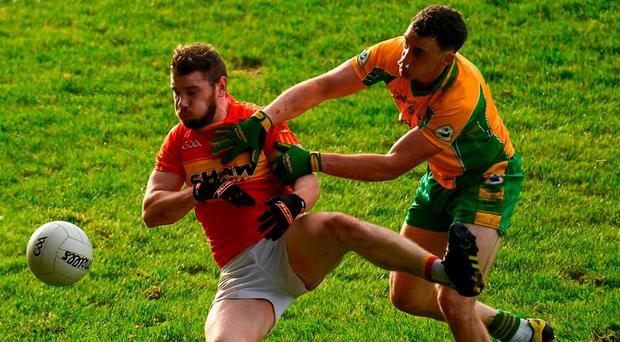 Castlebar's Fergal Durkan is tackled by Ronan Steede. Steede was substituted no fewer than five times during the Connacht club football semi-final due to a recurring nosebleed. Photo by Ramsey Cardy/Sportsfile