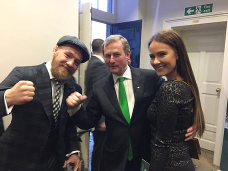 Taoiseach Enda Kenny with Conor McGregor and his girlfriend Dee Devlin
