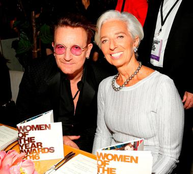 Bono and IMF managing director Christine Lagarde at the Glamour Women of the Year dinner in Hollywood. Photo: Rachel Murray/Getty. Photo: Jordan Strauss/AP.