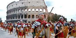Ancient Roman soldiers parade in front of the Colosseum during celebrations of the birth of Rome. For Italy, as for many other countries, the euro has been a disaster. Photo: Getty