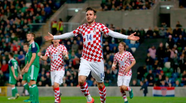 Croatia's Duje Cop (centre) celebrates scoring his side's second goal of the game during the International Friendly at Windsor Park