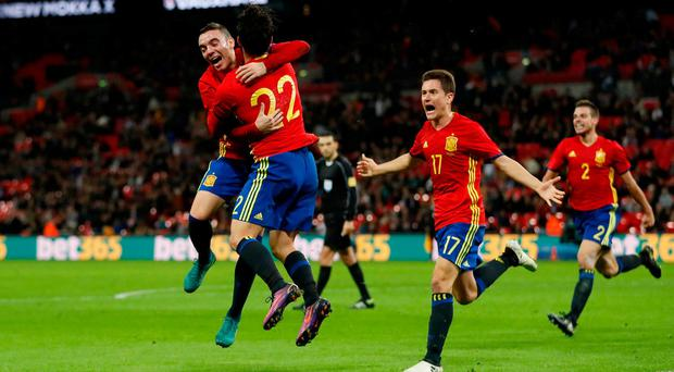 Spain's Isco celebrates scoring their late leveller