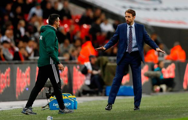 England's interim manager Gareth Southgate has words with the fourth official after Spain's late equaliser. Action Images via Reuters / Carl Recine