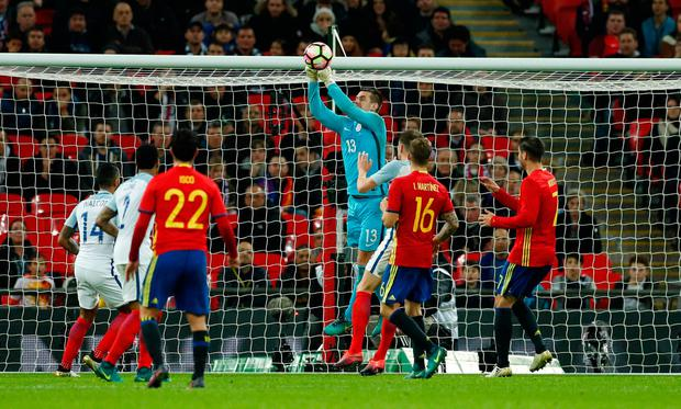 Tom Heaton punches a cross away from the England goal. Action Images via Reuters / John Sibley