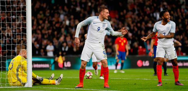 Jamie Vardy and Raheem Sterling celebrate together after Vardy doubles England's lead. (AP Photo/Kirsty Wigglesworth)