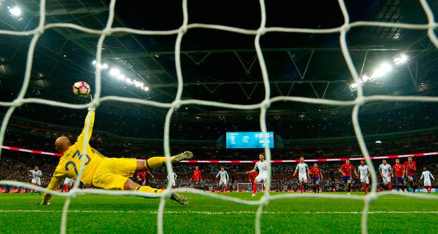 Adam Lallana puts England ahead from the penalty spot. Photo: Reuters / Eddie Keogh