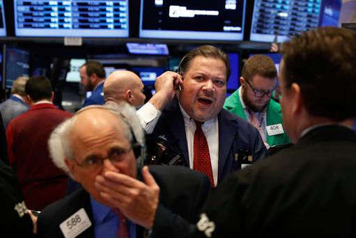 Traders work on the floor of the New York Stock Exchange (NYSE) shortly after the opening bell in New York City. Photo: Reuters