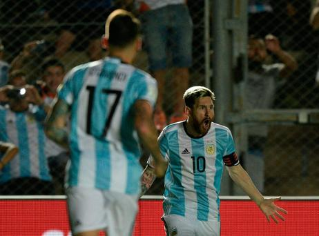 Argentina's Lionel Messi (R) celebrates with teammates after scoring against Colombia during their 2018 FIFA World Cup qualifier football match in San Juan, Argentina