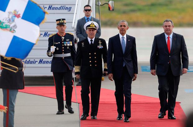 U.S. President Barack Obama walks next to Greek National Defence Minister Panos Kammenos, right, after his arrival at the Athens International Airport Eleftherios Venizelos on Tuesday, November 15, 2016. Photo: AP Photo/Thanassis Stavrakis