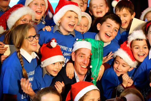 Ryan Tubridy in Dublin with pupils of St Margaret's National School. Photo: Gerry Mooney