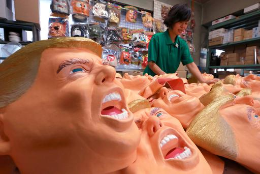 A worker puts the finishing touches to rubber masks depicting president-elect Donald Trump in Japan – but we won't see his real face until he enters the White House. Photo: AP