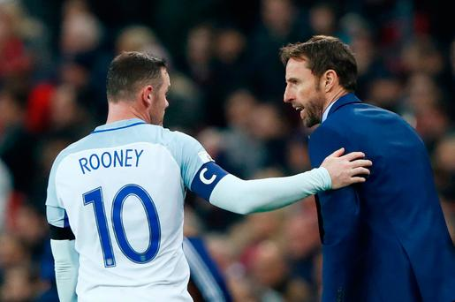 Rooney Alongside manager Gareth Southgate. Photo: Reuters