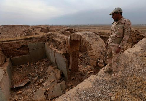 An Iraqi soldier looks to the damaged ancient site of Nimrud, which was destroyed by Isil militants. Photo: AP