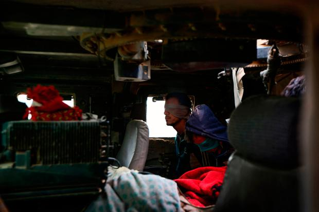 Blindfolded suspected Isil jihadists sit in a Humvee after they were captured by Iraqi forces near Nimrud. Photo: Getty