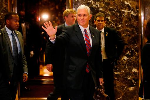 Vice president-elect Mike Pence departs Trump Tower in New York after meeting with Donald Trump. Photo: Reuters