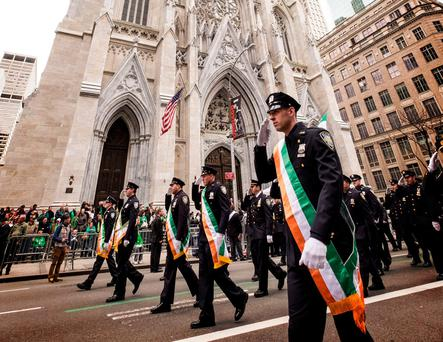 Police officers march in the annual St Patrick's Day parade in New York. Ireland has been sending its citizens across the globe for centuries. Photo: Getty