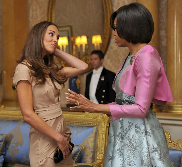 US First Lady Michelle Obama (R) meets with Catherine, Duchess of Cambridge at Buckingham Palace on May 24, 2011 in London, England. (Photo by Toby Melville - WPA Pool/Getty Images)