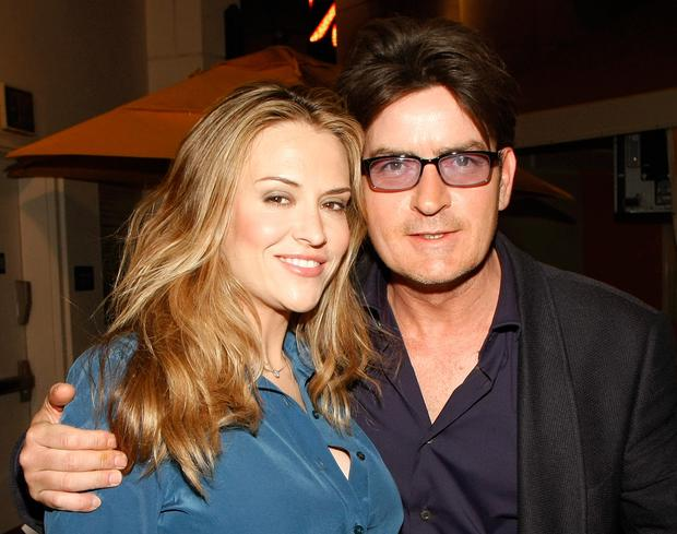 Actor Charlie Sheen (R) and his wife Brooke Sheen appear at the after party for the world premiere of the adult production