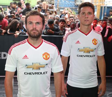LONDON, ENGLAND - AUGUST 11: Juan Mata and Ander Herrera of Manchester United attend the global launch of the 2015-16 Manchester United away kit on August 11, 2015 in London, England. (Photo by John Peters/Man Utd via Getty Images)