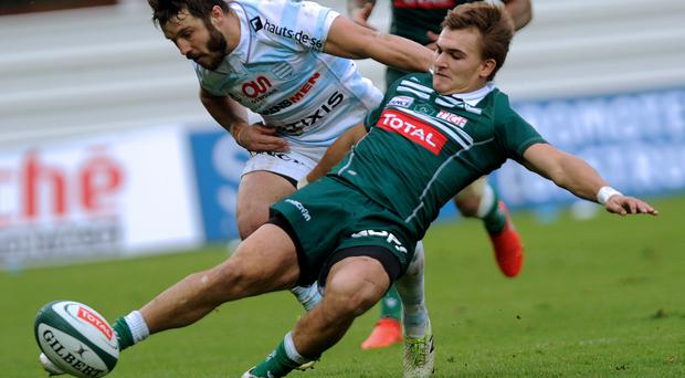 Pau's French winger Bastien Pourailly (R) kicks the ball during the French Top 14 rugby union match between Section Paloise and Racing Paris 92 at the Hameau stadium. AFP/Getty Images