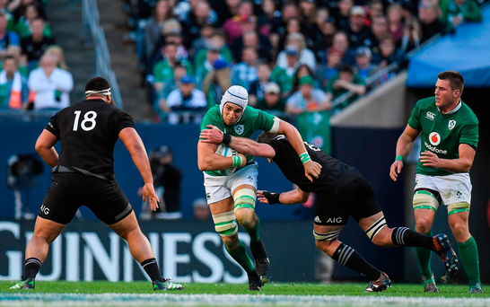 Ultan Dillane is tackled by New Zealand's Liam Squire in Soldier Field. Photo: Sportsfile
