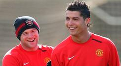 Wayne Rooney and Cristiano Ronaldo have experienced contrasting fortunes since their days together at Manchester United. Photo by Alex Livesey/Getty Images