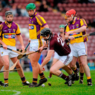 Galway's Joe Cooney is tackled by a posse of Wexford defenders during a 2011 league clash in Pearse Stadium, but the Model hurlers will not be travelling west to play them in the Leinster championship. Photo: Sportsfile