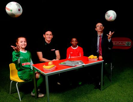 Keith Andrews and Martin O'Neil with St Bernadette's Clondalkin pupils Abbie Tucker and Akinola Adeyinka at the launch of the Spar FAI Primary School 5s. Photo: Sportsfile