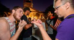 Supporters (left) of Donald Trump argue with protesters demonstrating against him in Florida. Photo: Reuters