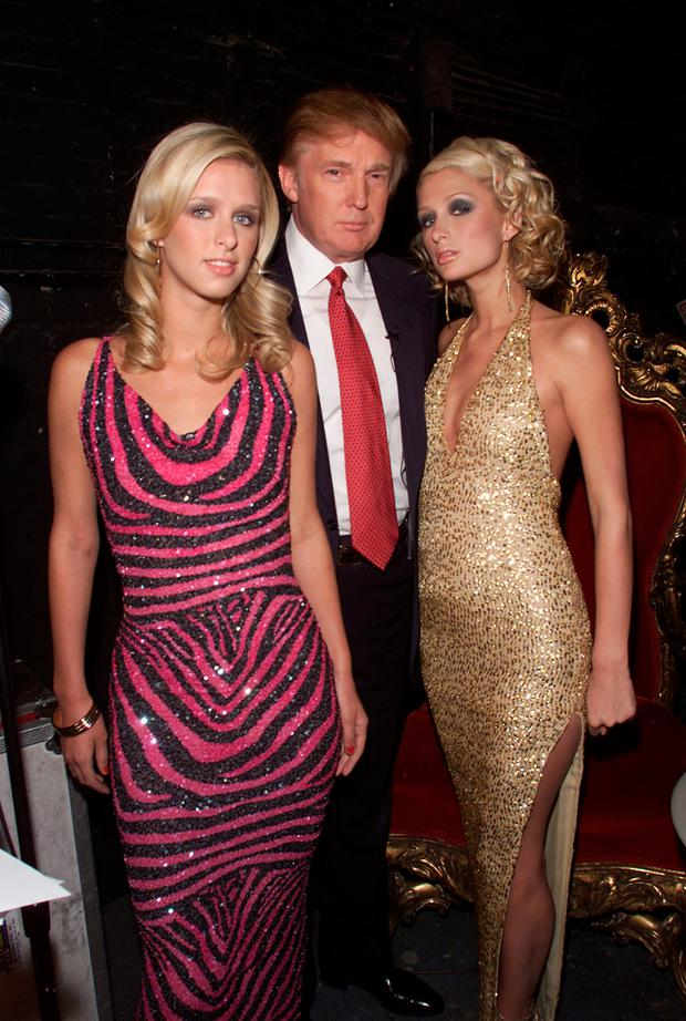 Donald Trump with Paris and Nicky Hilton during rehearsals for the 2001 VH1 Vogue Fashion Awards at Hammerstein Ballroom in New York City