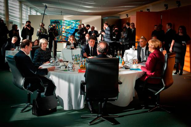 Prime Minister Theresa May speaks with German Chancellor Angela Merkel, US President Barack Obama, French President, Francois Hollande, the Italian prime minister, Matteo Renzi, and Spain's Prime Minister Mariano Rajoy during a meeting in Berlin with the leaders of the USA, Germany, France, Italy and Spain Credit: Stefan Rousseau/PA Wire