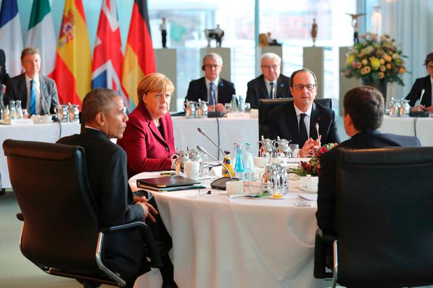 U.S. President Barack Obama, German Chancellor Angela Merkel, French President Francois Hollande and Italian Prime Minister Matteo Renzi meet at the chancellery in Berlin, Germany, November 18, 2016. REUTERS/Kay Nietfeld/POOL