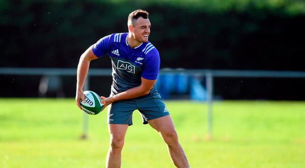 Israel Dagg of New Zealand reacts after falling over a tackle bag during squad training at Garda RFC in Westmanstown, Dublin. Photo by Stephen McCarthy/Sportsfile