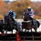 Thomas Campbell (right), with Barry Geraghty up, clears the last on the way to winning The Olympus Inroductory Hurdle Race at Ascot. Photo by Alan Crowhurst/Getty Images