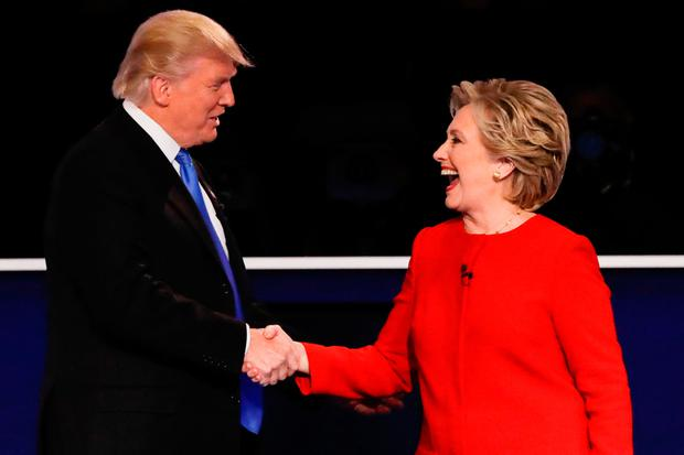 Rivals Donald Trump and Hillary Clinton shake hands before one of their political debates in the run up to the US presidential election Photo: AP Photo/David Goldman