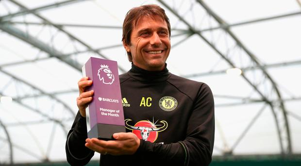 Antonio Conte accepting his October manager of the month. Photo by Christopher Lee/Getty Images for Premier League