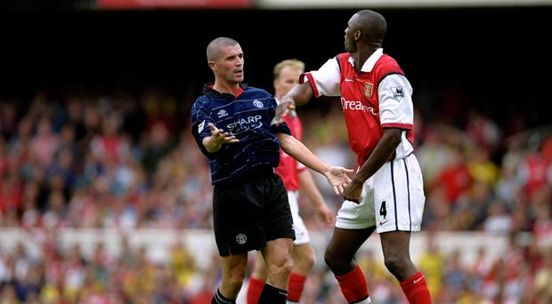 Roy Keane and Patrick Vieira clash at Highbury in 1999 during one of their many battles. Photo credit: Clive Brunskill /Allsport