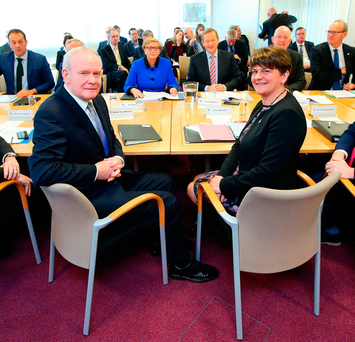 Northern Ireland Deputy First Minister Martin McGuinness and First Minister Arlene Foster sitting across a table from Taoiseach Enda Kenny and members of his Cabinet at the North South Ministerial Council meeting in Armagh yesterday Photo: Kelvin Boyes/Press Eye