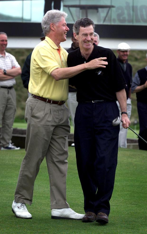 Dick Spring playing golf with Bill Clinton at Ballybunion in 2001 Picture: Steve Humphreys