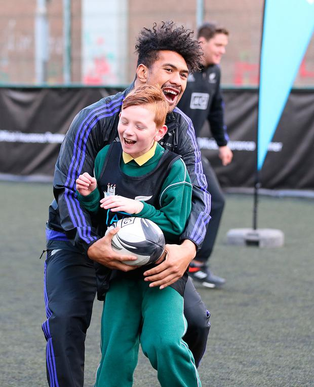 Cian Fuller is caught by All Black Ardie Savea at St Laurence O'Toole's CBS Photo: Frank Mc Grath