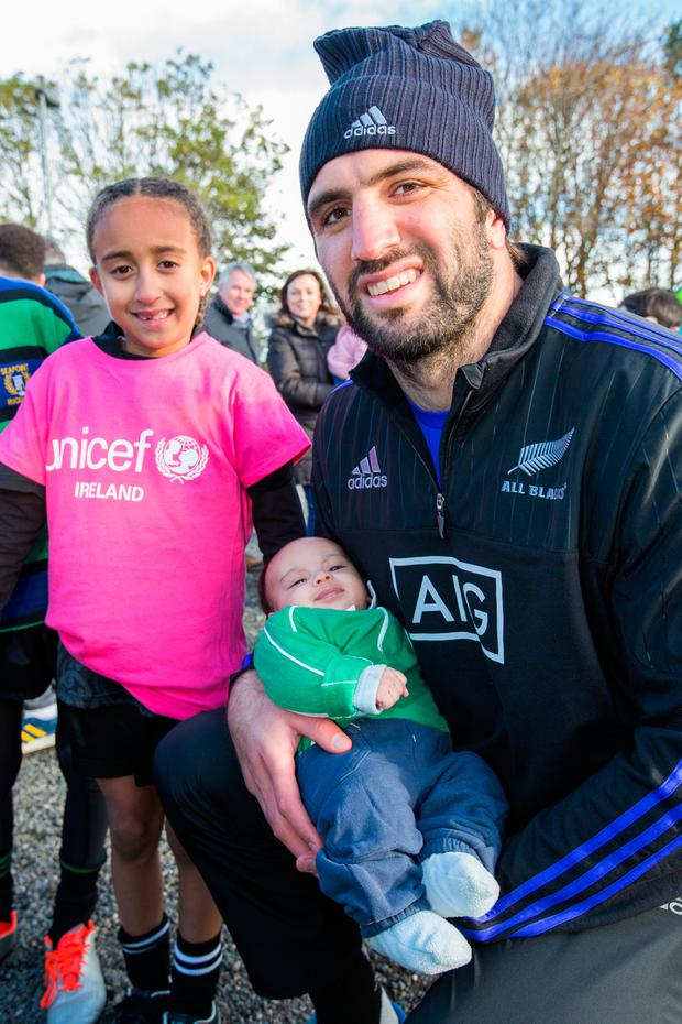 All Black Sam Whitelock with Maya Keegan (7) and her baby brother Jonah Photo: Naoise Culhane