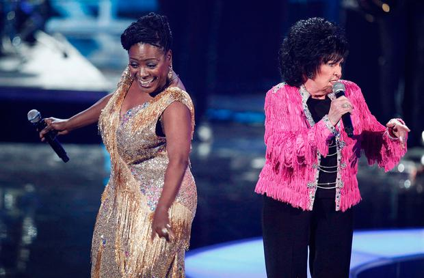 Singers Sharon Jones (L) and Wanda Jackson perform during the