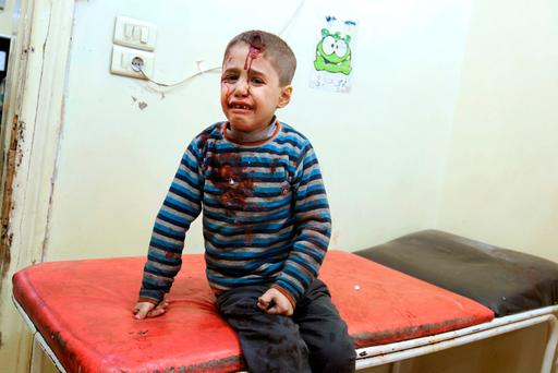 An injured boy reacts inside a field hospital after airstrikes on the rebel held areas of Aleppo, Syria November 18, 2016. REUTERS/Abdalrhman Ismail