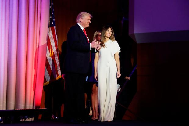 Republican president-elect Donald Trump acknowledges the crowd along with his wife Melania Trump during his election night event at the New York Hilton Midtown in the early morning hours of November 9, 2016 in New York City. Donald Trump defeated Democratic presidential nominee Hillary Clinton to become the 45th president of the United States. (Photo by Chip Somodevilla/Getty Images)
